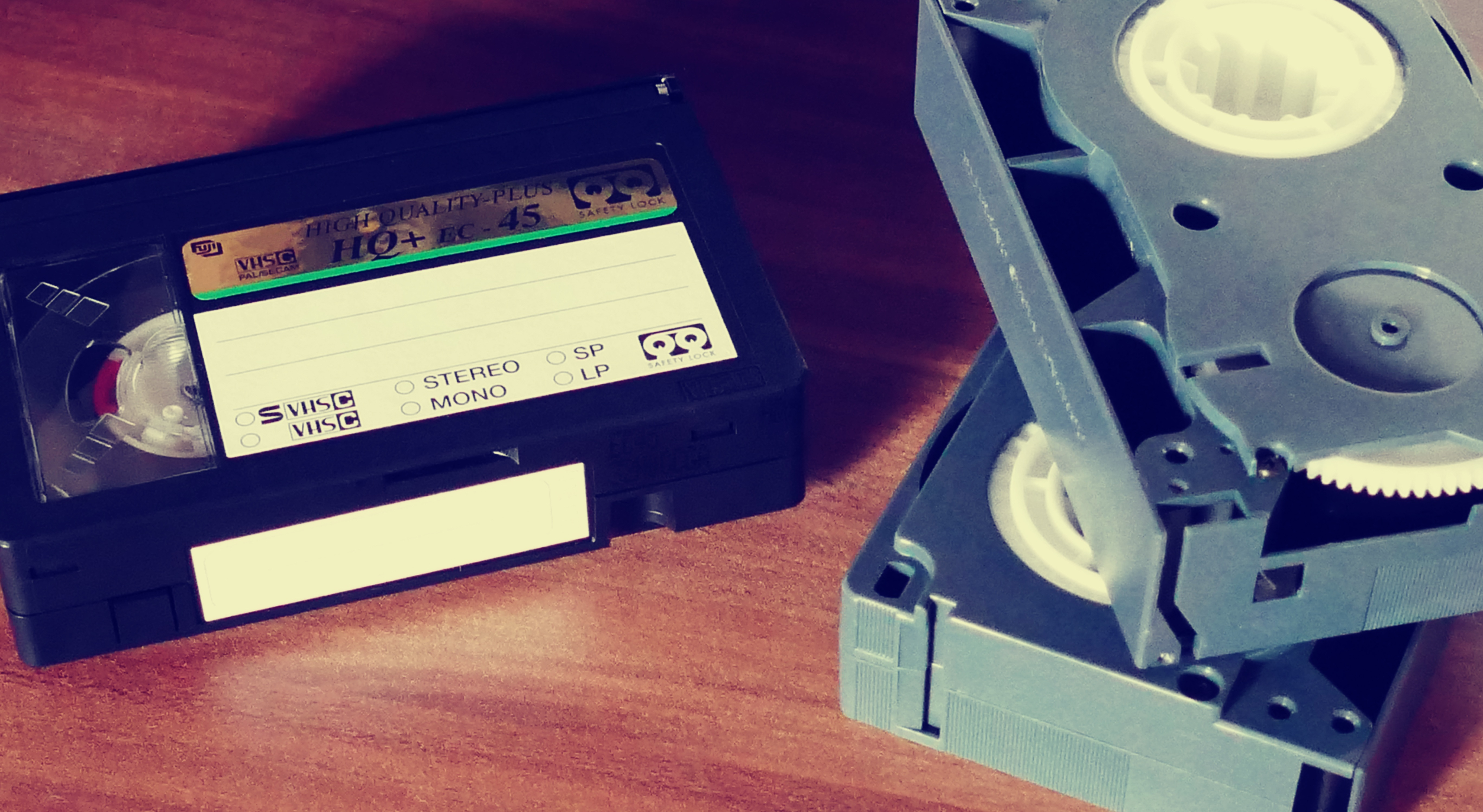 canva-3-vhs-tape-on-top-of-table.jpg